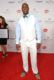 Gary Payton opted for a white vest and pants combo sans jacket when he attended the Kentucky Derby Moet & Chandon toast.