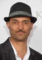 Trevor Holland opted for a black fedora instead of the traditional straw hat when he attended the Kentucky Derby Moet & Chandon toast.