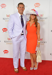 Angela Mecca looked sexy and modern in an orange cutout dress at the Kentucky Derby Moet & Chandon toast.
