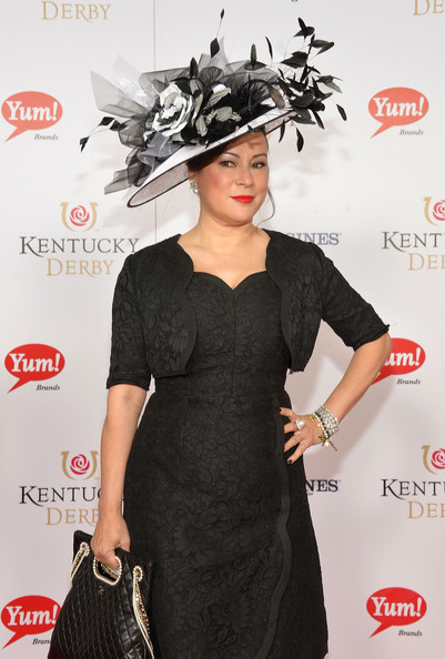 Jennifer Tilly contrasted her simple dress with an elaborate black-and-white decorative hat at the Kentucky Derby Moet & Chandon toast.