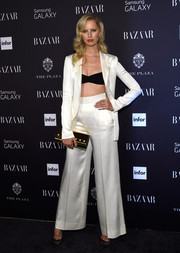 Karolina Kurkova injected some shimmer via a metallic gold Versace clutch.