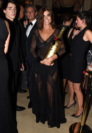 Carine Roitfeld wasn't afraid to show lots of skin at the Harper's Bazaar Icons event. She wore a multitextured, geometric-paneled sheer black gown.