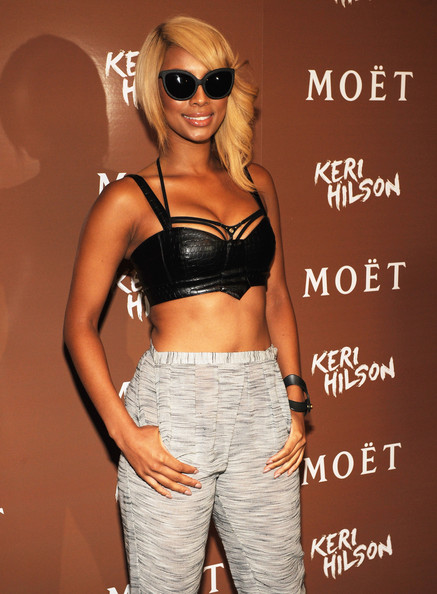 Keri Hilson hosted a party in Atlanta at the Moet Rose Lounge wearing a skimpy leather bustier with high-waisted textured pants. The songstress debuted a new asymmetrical 'do and rocked a pair of cat eye shades and a leather bracelet.