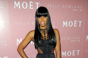 Singer Kelly Rowland poses for photo at the Moet Rose Lounge during the launch celebration for her new album