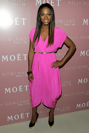Tika Sumpter made an entrace at Kelly Rowland's new album launch in a pair of black pumps with gold platforms. The heels added sizzle to her feminine bubblegum pink wrap dress.