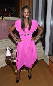 Tika Sumpter looked funky in her bright pink bubble-hem dress at the 'Here I Am' album launch.
