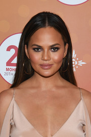 Chrissy Teigen sealed off her look with a pair of  gold hoops.