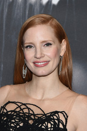 Jessica Chastain accessorized with an elegant pair of dangling diamond earrings by Piaget.