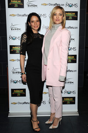 Kate Hudson donned a pink two-piece, consisting of a long blazer and tapered slacks, for the Moms Mamarazzi 'Kung Fu Panda 3' screening.