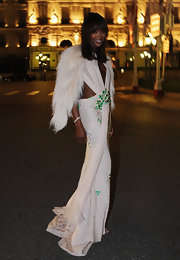 Naomi Campbell wowed at the Monaco royal wedding in a white halterneck ecru Couture 2009 gown embroidered with emerald stones.