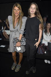 Anna dello Russo completed her ensemble with a black-and-white printed shoulder bag by Chanel.