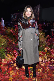 Miroslava Duma showed off her vibrant cold-weather style with this metallic-embroidered houndstooth coat at the Moncler Gamme Rouge fashion show.