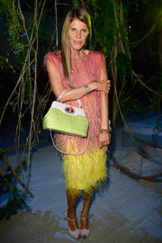 Anna dello Russo added another layer of color to her multi-hued outfit with a green Bulgari crocodile tote.