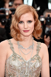 Jessica Chastain attended the Cannes premiere of 'Money Monster' sporting vintage-glam waves.
