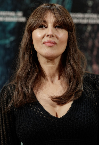 Monica Bellucci Long Wavy Cut with Bangs [on the milky road,madrid photocall,hair,face,hairstyle,layered hair,beauty,eyebrow,bangs,long hair,chin,brown hair,monica bellucci,urso,photocall,milky road,madrid,hotel,spain]