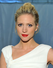 Brittany Snow rocked bold red lips at the Monique Lluillier fashion show. She highlighted her perfect pout with a high bun.