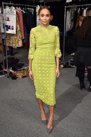 Ashley Madekwe brightened up the Monique Lhuillier fashion show with this chartreuse lace sheath dress from the brand.
