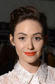Emmy Rossum perked up her otherwise pale beauty look wtih a swipe of bright orange lipstick when she attended the Monique Lhuillier fashion show.