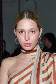 Princess Maria-Olympia opted for a simple center-parted ponytail when she attended the Monse fashion show.