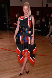 Nicky Hilton Rothschild paired her dress with a black leather clutch by Hermes.