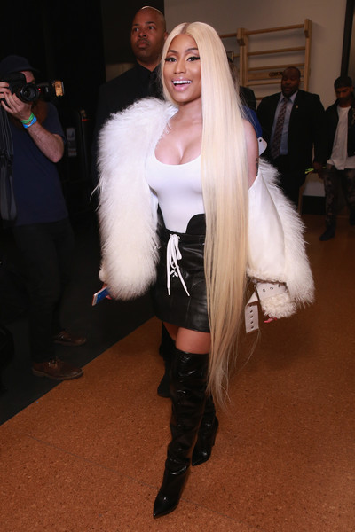 Nicki Minaj showed off her curves in a tight white tank top at the Monse fashion show.