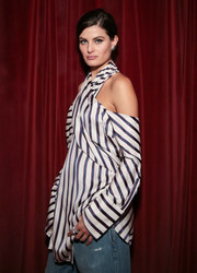 Isabeli Fontana was trendy in a striped cold-shoulder blouse at the Monse launch party.
