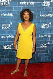 Alfre Woodard opted for a pop of yellow with this sleeveless, embroidered v-neck cocktail dress.