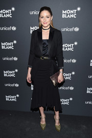 Olivia Palermo balanced out her masculine-chic top with a black ruffle-hem skirt by Michael Kors.