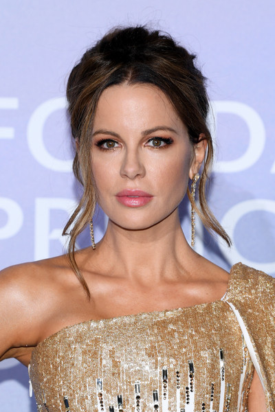 Kate Beckinsale styled her hair into an elegant loose bun with wavy tendrils for the Monte-Carlo Gala for Planetary Health.