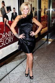 Kerry Katona donned ladylike platforms with knotted peep toes with her fun feathered dress.