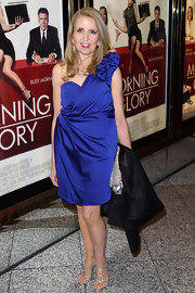 Gillian McKeith paired her bold-shouldered blue cocktail dress with strappy silver sandals.