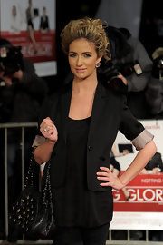Chantelle wears a black blazer with rolled up sleeves for this laid back red carpet style.