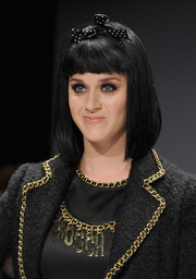 Katy Perry attended the Moschino Fall 2014 show wearing her hair in a mid-length bob with blunt bangs.
