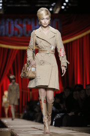 This beige number Gigi Hadid wore on the Moschino runway was a super-fun spin on the classic trenchcoat!