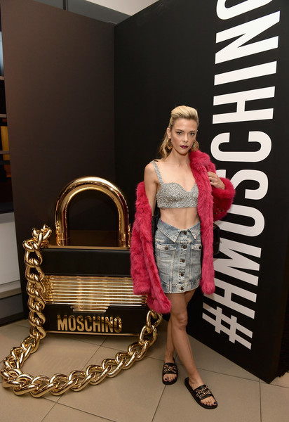 Jaime King was casual in a chain-embellished slides by Moschino x H&M during the brand's Los Angeles launch event.
