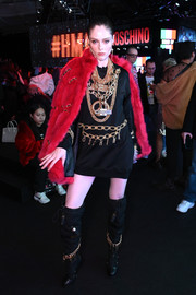 Coco Rocha was tough-chic in an embellished black hoodie at the Moschino x H&M fashion show.