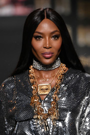 Naomi Campbell got blinged up with layers of gold necklaces.