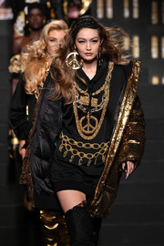 Gigi Hadid rocked a chain-embellished hoodie at the Moschino x H&M runway show.