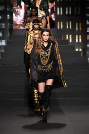 Gigi Hadid strode down the Moschino x H&M runway wearing a pair of chain-embellished thigh-high boots.