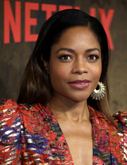 Naomie Harris went for bold styling with a chunky gold hoop.