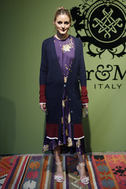 Olivia Palermo layered a long cardigan by Comme Moi over a purple print dress for the Mr & Mrs Italy presentation.
