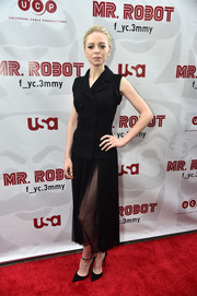 Black ankle-strap pumps sealed off Portia Doubleday's attire.