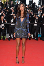 Liya Kebede went for a sexy '20s vibe in a Roberto Cavalli beaded mini with a plunging neckline during the 'Mr. Turner' premiere.