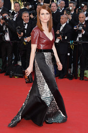 Julianne Moore oozed edgy sophistication in a low-cut red leather top by Louis Vuitton at the 'Mr. Turner' premiere.