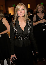 Bo Derek's fitted black blouse really played up her slim waist.