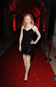 Mireille Enos walked down the red carpet premiere of 'World War Z' wearing a sequined dress and a pair of black pumps.