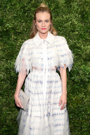 Diane Kruger arrived for the Museum of Modern Art's film benefit carrying a gray Chanel double-C beaded clutch.