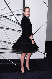 Leelee Sobieski cut a shapely silhouette in a fit-and-flare zip-front LBD during the benefit tribute to Alfonso Cuaron.
