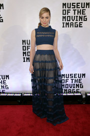 Melissa George kept the playfully sexy vibe going with a teal sheer-panel maxi skirt.