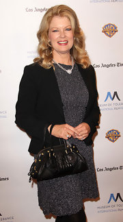 Mary Hart paired her cropped blazer and grey dress with a leather tote bag, that was the perfect size for the occasion.